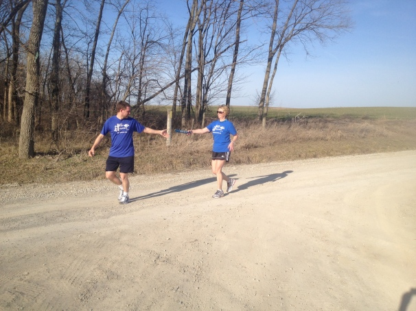 Handing off the East baton to Bernard Krumpelman in Davis, MO after my last leg and Mid-MO portion of Relay.
