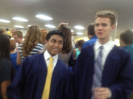 Alex after graduation with his friend Earl.