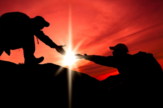 bigstock-Silhouette-of-helping-hand-bet-35213948